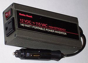 Power inverter - Inverter designed to provide 115 V AC from the 12 V DC source provided in an automobile. The unit shown provides up to 1.2 amperes of alternating current, or enough to power two sixty watt light bulbs.