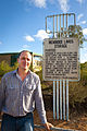 Jeremy Buckingham MLC standing next to the Menindee Lakes storage sign.jpg