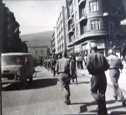 Marshal Tito Street in Skopje (26 July 1963, the Yugoslav People's Army support staff for earthquake) Jugoslovenska narodna armija na ulica Marsal Tito.jpg