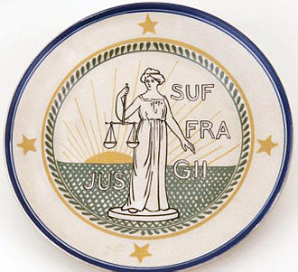 "International Alliance of Women - Plate with the symbol and motto of the International Woman Suffrage Alliance (IWSA). Text: ""Jus Suffragii"" (the right to vote). Lady Justitita holding a balance in her right hand."