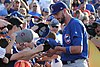 Kris Bryant signing autographs during his rehab assignment against Omaha (42507302760).jpg