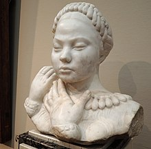 Sculpture (bust) of a young woman with braided hair and hands touching one shoulder, representing Lada