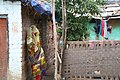 Lady in a village house.jpg