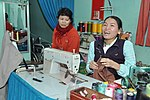 Le Thi Het receives support to boost her income from sewing. (6586866973).jpg