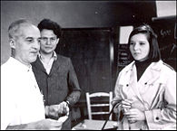 Leloir(left) with Armando Parodi and his daughter Amelia in the laboratory.