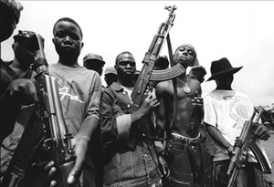 Second Liberian Civil War - Unidentified Liberian rebel fighters, including child soldiers.