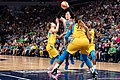 Lindsay Whalen (13) passes the ball as she's guarded by Chicago Sky players.jpg