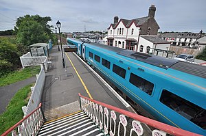 Llanfairpwll railway station - A passenger train pulling through the station, as viewed from the footbridge between the two platforms