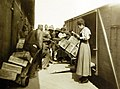 Loading a railroad car with rations, Dijon, France, AEF, WWI, 1918 (30477195970).jpg