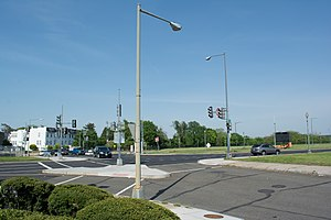 Barney Circle - Standing on K Street SE, looking north-northeast at Barney Circle. Pennsylvania Avenue SE southbound is cutting across the image left to right. The traffic attempting to access Pennsylvania Avenue SE is on Barney Circle SE, part of the traffic circle itself.