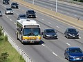 MBTA route 558 bus on the Mass Pike, August 2018.JPG