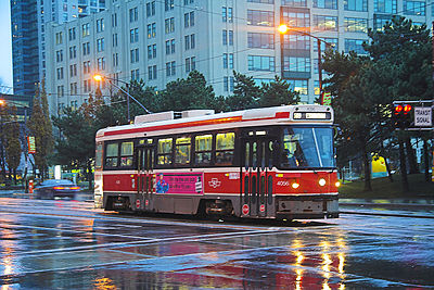 A streetcar during a rainy day downtown.