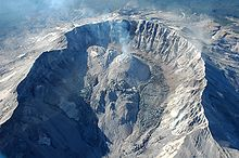 Summit crater with lava domes in center and rocky glaciers growing on the side