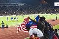 Malaysia fans waving flag.jpg