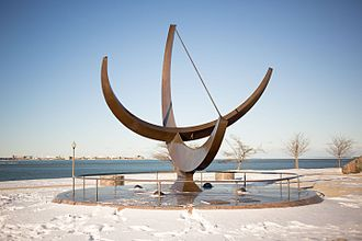 Man Enters the Cosmos - The sculpture as seen with Lake Michigan in the background