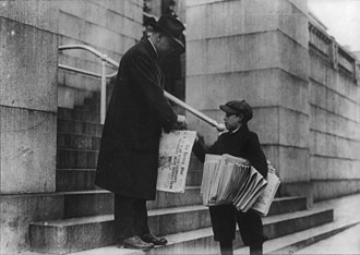 The Washington Star - A young boy sells The Evening Star to a man