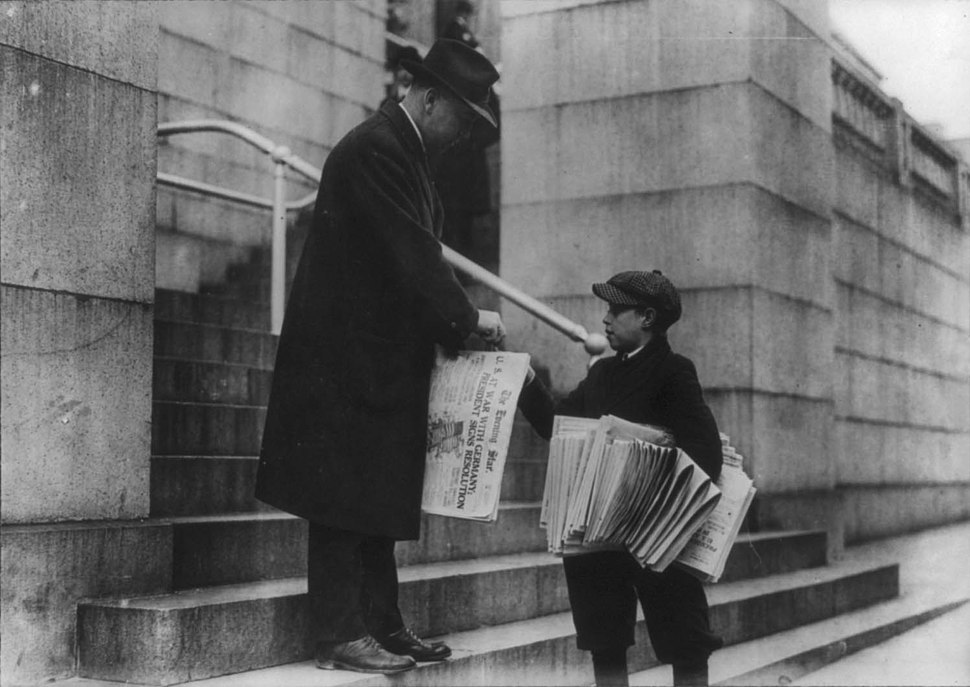 Man buying The Evening Star from newsboy, Washington, D.C. - headline reads %22U.S. at War with Germany%22 LCCN2001706358