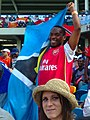 Man with Saint Lucia flag.jpg
