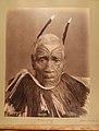 Maori chief, Teretimana Terurapoutu, poses against a plain background. He has a thin white beard, short, white hair decorated (a5ad45d5-4b05-4245-af9f-e5daf4864139).JPG