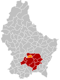 Map of Luxembourg with Walferdange highlighted in orange, the district in dark grey, and the canton in dark red