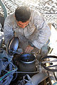 Marine mechanic single-handedly maintains battery vehicles 130502-M-OM885-528.jpg