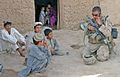 Marines protect Afghans during firefight in Marjah DVIDS310546.jpg