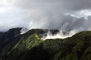 """Meghalaya - Meghalaya is mountainous, the most rain soaked state of India. The word Meghalaya means, """"abode of the clouds"""". Above is Laitmawsiang landscape wrapped in fog."""