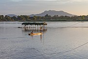 Mekong pirogue at sunset in the 4000 islands.jpg