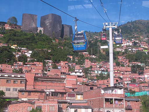 Cable cars high above the hills of Medellin with Santo Domingo in the background