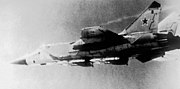 MiG-31 Foxhound aircraft armed with AA-9 missiles in flight