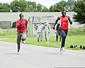 Mike Tebulo, left, a Malawian Olympic marathon runner, races toward the finish line with British Armed Forces Lance Cpl. Francis Okumu, with the Allied Rapid Reaction Corps (ARRC), at Imjin Barracks, Innsworth 120712-O-ZZ999-003.jpg