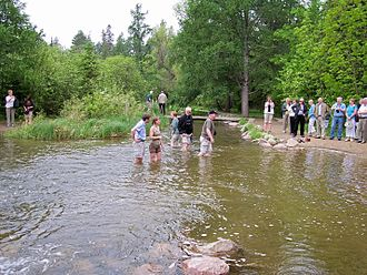 Itasca State Park - Tourists wade the Mississippi near Lake Itasca in 2007