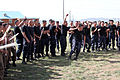 Mongolian police officers cheer on their representatives during a competition as part of Non-Lethal Weapons Executive Seminar (NOLES) 13 at Five Hills Training Area, Mongolia, Aug. 19, 2013 130819-M-DR618-027.jpg
