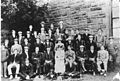 Mr & Mrs Smith-Hill with staff and scholars circa 1900.jpg