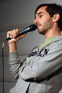 Myq Kaplan, the Meltdown, December 2011.jpg