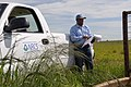 NRCS District Conservationist Calvin Devereaux completes status review on rotational grazing system with fencing, water storage facility and grass planting in Wheeler, Texas. (25116542545).jpg