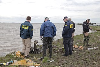 Atlas Air Flight 3591 - NTSB investigators examine debris at the edge of Trinity Bay
