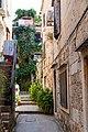 Narrow street in Komiza, Croatia (48693534323).jpg