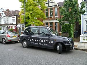 YOOX Net-a-Porter Group - A Net-a-Porter branded taxi in London.