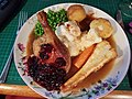 New Years Day lunch of roast Duck, roast potatoes, carrots & parsnips with cauliflower cheese, peas and cherry sauce with gravy. (31655894917).jpg