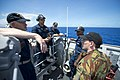New Zealand Defense Force Capt. Paul Stanaway, right, a chaplain, speaks with U.S. Sailors aboard the amphibious dock landing ship USS Pearl Harbor (LSD 52) May 26, 2013, in the Pacific Ocean during Pacific 130526-N-WD757-040.jpg