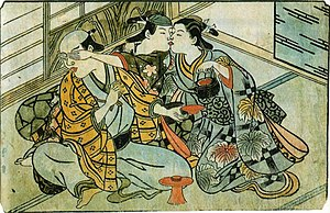 History of bisexuality - A wakashū (wearing headscarf) sneaks a kiss from a female prostitute behind his patron's back. Nishikawa Sukenobu, ca. 1716–1735. Hand-colored shunga print.
