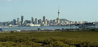 Auckland Northern Motorway - The Northern Motorway skirting the edge of the Waitematā Harbour on the northern approach to the Auckland Harbour Bridge. Central Auckland can be seen across the harbour.