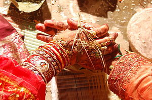 Odia Hindu wedding - Hata Ganthi, or Panigrahana ritual of tying knot by keeping the bride's palm on groom's