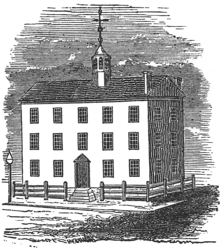 Black and white engraving shows a three-story building with a gabled roof and a belfry.