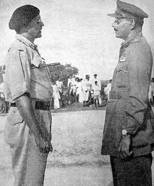 Indian annexation of Hyderabad - Major General Syed Ahmed El Edroos (at right) offers his surrender of the Hyderabad State Forces to Major General (later General and Army Chief) Joyanto Nath Chaudhuri at Secunderabad
