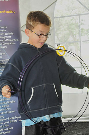 Argonne National Laboratory - A student examines Argonne's Gyro Wheel at the Open House.
