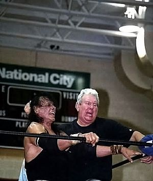 Bob Orton Jr. - Orton (right) driving Jimmy Snuka (left) into a turnbuckle in 2009.