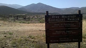 Otay Mountain Wilderness - Signpost of Otay Mountain Ecological Reserve with Otay Mountain in the background