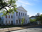 This building was erected between 1880 and 1886 to provide proper housing for the Stellenbosch College. This so-called Main Building is in the Neo-Classical style, Carl Hager being the architect, and played an important part in the history of the Victoria College and later the University of Stellenbosch.